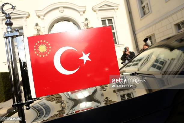 A Turkish flag is seen at the car of the Turkish President at the presidential Bellevue castle on September 28 2018 in Berlin Turkish President Recep...