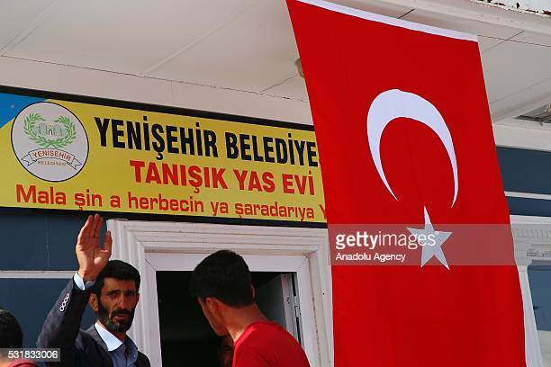 Turkish flag is seen, hung on a mourning building, before the funeral ceremony of the 13 victims, killed by PKK terrorist organization's bomb-laden...