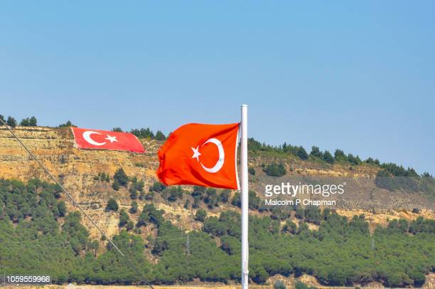 turkish flag on hillside and on ferry boat, galipoli, turkey - gallipoli stock pictures, royalty-free photos & images