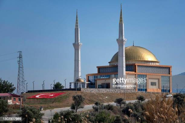 turkish flag on the ground in front of abdulkadir kanat mosque in kemalpasa - emreturanphoto stock pictures, royalty-free photos & images