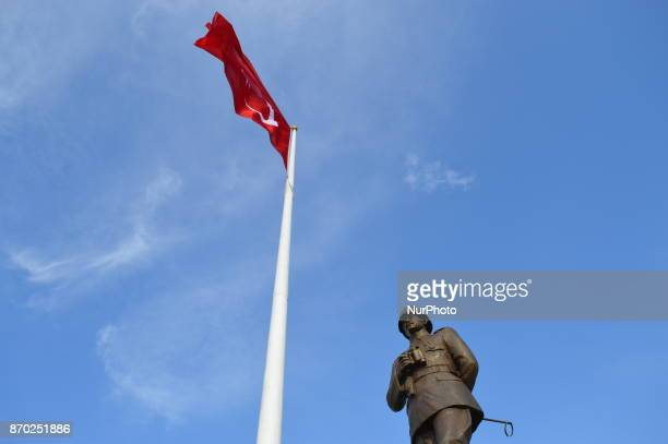 A Turkish flag waves over a statue of Mustafa Kemal Ataturk founder and the first president of modern Turkey at Chunuk Bair on the Gallipoli...