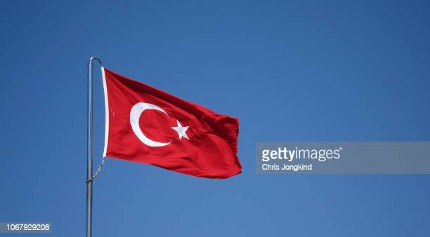 turkish flag waving against blue sky - insignia stock pictures, royalty-free photos & images