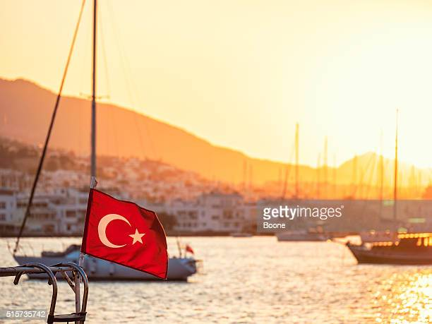 Turkish flag waving in the wind in Bodrum harbor