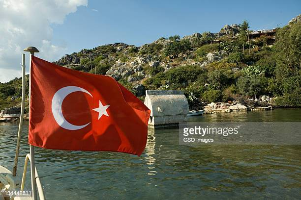turkish flag with sunken tomb