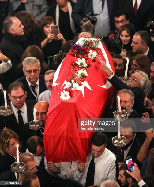 Turkish flagdraped coffin of legendary Turkish photographer Ara Guler is being carried during his funeral ceremony at Beyoglu Uc Horan Armenian...