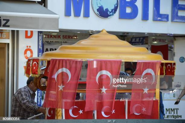 Turkish flags are seen around a bagel counter during a hot summer day in Ankara Turkey on July 06 2017