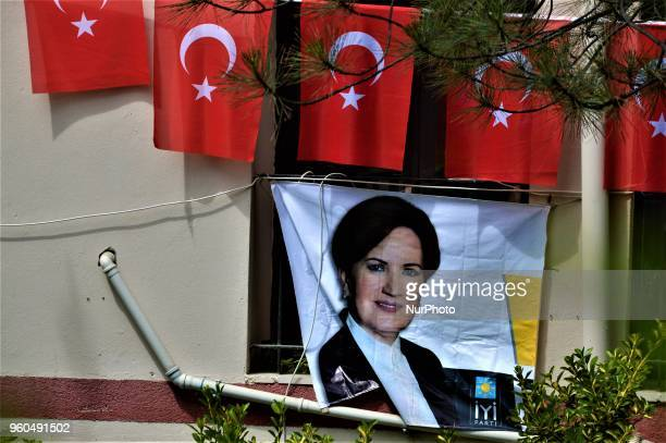 Turkish flags are seen over a portrait picturing Meral Aksener presidential candidate and the leader of the opposition IYI Party during a rally in...