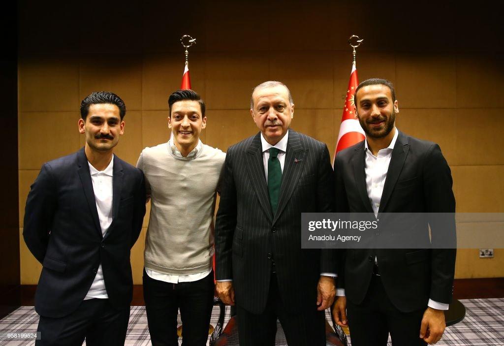 Turkish football players Ilkay Gundogan (L), Mesut Ozil (L-2) and Cenk Tosun (R) pose for a photo with Turkish President Recep Tayyip Erdogan (R-2) in London, United Kingdom on May 13, 2018.