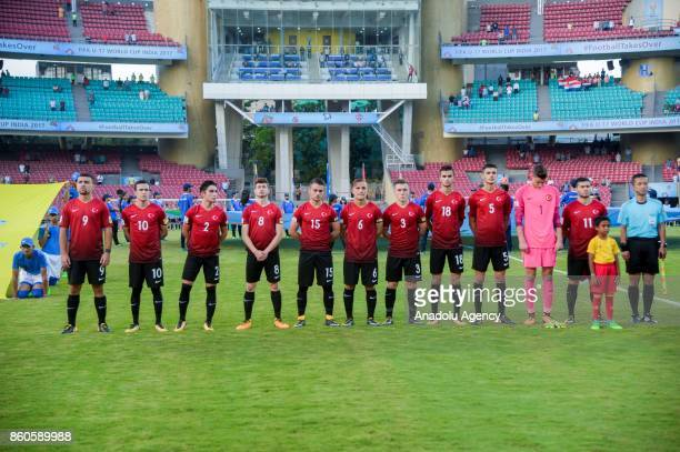 Turkish footballers are seen during the national anthem ceremony before the 2017 FIFA U17 World Cup football match between Turkey U17 and Paraguay...