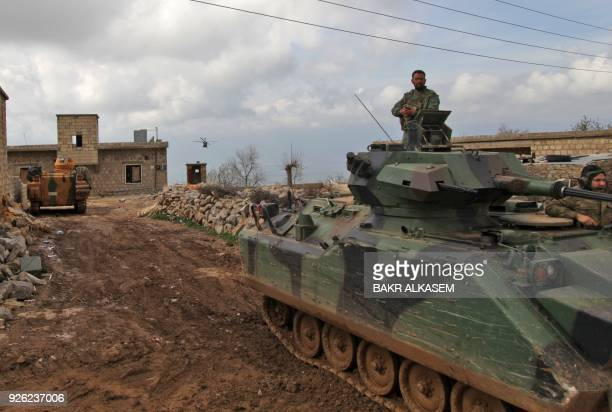 Turkish forces and army helicopters advance towards the village of AlMaabatli in the Afrin region in the northwestern Aleppo province countryside as...