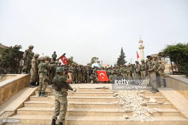 TOPSHOT Turkish forces pose for a group photo in the Kurdishmajority city of Afrin in northwestern Syria after seizing control of it on March 18 2018...