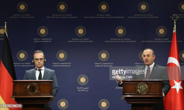 Turkish Foreign Affairs Minister Mevlut Cavusoglu and his German counterpart Heiko Maas give a joint press conference after their meeting at the...