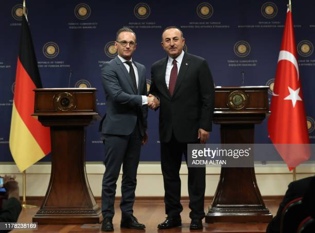 Turkish Foreign Affairs Minister Mevlut Cavusoglu and his German counterpart Heiko Maas pose before a joint press conference after their meeting at...