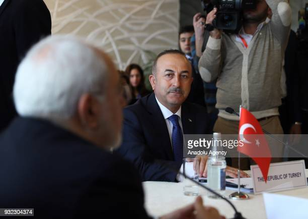 Turkish Foreign Affairs Minister Mevlut Cavusoglu and Iranian Foreign Minister Mohammad Javad Zarif attend the first Quadrilateral Meeting of Foreign...