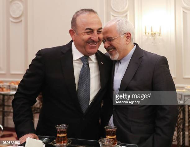 Turkish Foreign Affairs Minister Mevlut Cavusoglu and Iranian Foreign Minister Mohammad Javad Zarif attend the ninth round of Syria peace talks in...