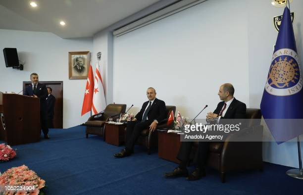 """Turkish Foreign Affairs Minister Mevlut Cavusoglu and Turkish Cypriot counterpart Kudret Ozersay attend a symposium titled """"Politics and Law in East..."""