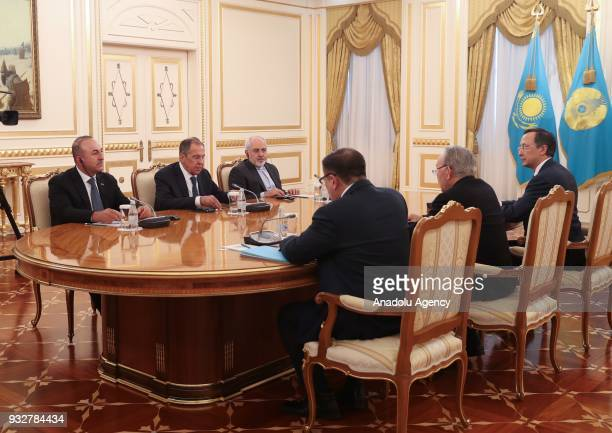 Turkish Foreign Affairs Minister Mevlut Cavusoglu President of Kazakhstan Nursultan Nazarbayev Russian Foreign Minister Sergei Lavrov and Iranian...