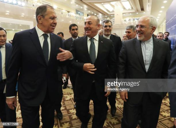 Turkish Foreign Affairs Minister Mevlut Cavusoglu Russian Foreign Minister Sergei Lavrov and Iranian Foreign Minister Mohammad Javad Zarif attend the...