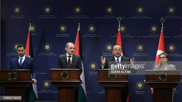 Turkish Foreign Affairs Minister Mevlut Cavusoglu talks during a joint press conference with Jordan Foreign Affairs minister Ayman Safadi Turkish...