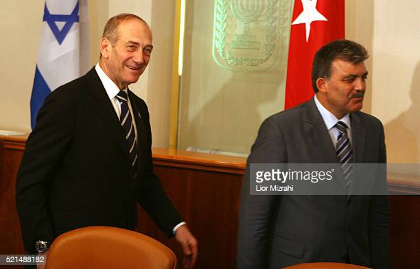 Turkish Foreign Minister Abdullah Gul and Israeli Prime Minister Ehud Olmert after their meeting in Jerusalem on Sunday Aug 20 2006