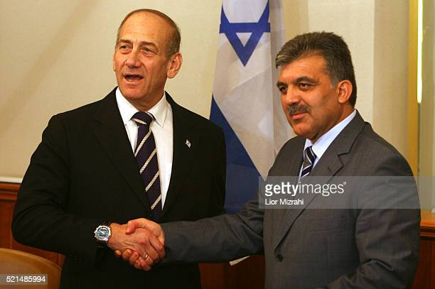 Turkish Foreign Minister Abdullah Gul shakes hands with Israeli Prime Minister Ehud Olmert after their meeting in Jerusalem on Sunday Aug 20 2006