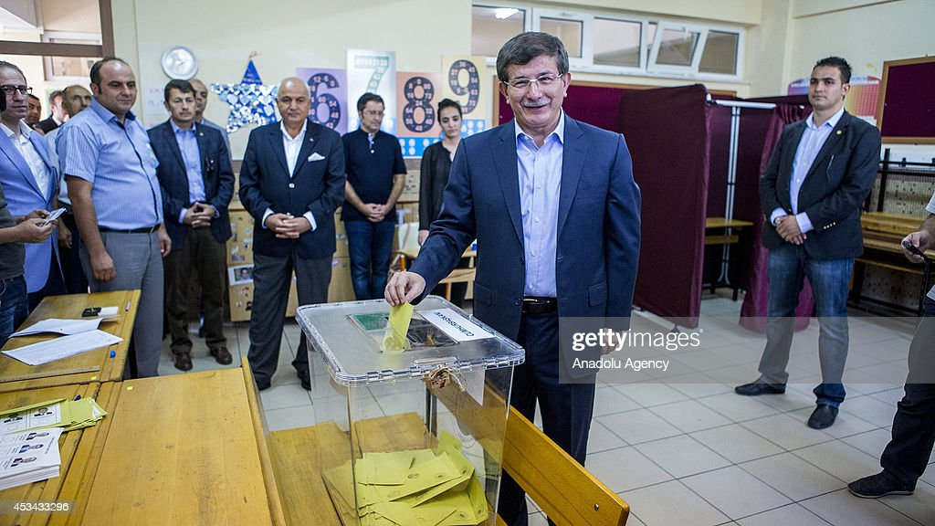 Turkish Foreign Minister Ahmet Davutoglu casts his vote in the Turkish presidential election at a polling station in Konya, central Anatolia region of Turkey on August 10, 2014. Millions of Turkish voters go to the polls Sunday for an election in which for the first time the president will be elected by popular vote.