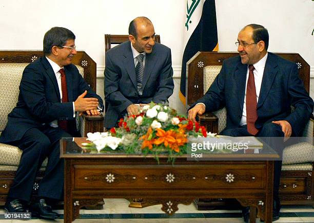 Turkish Foreign Minister Ahmet Davutoglu smiles as he meets with Iraqi Prime Minister Nuri alMaliki on August 31 2009 in Baghdad Iraq Davutoglu...