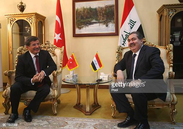 Turkish Foreign Minister Ahmet Davutoglu smiles as he meets with Iraqi Foreign Minister Hoshyar Zebari on August 31 2009 in Baghdad Iraq Davutoglu...
