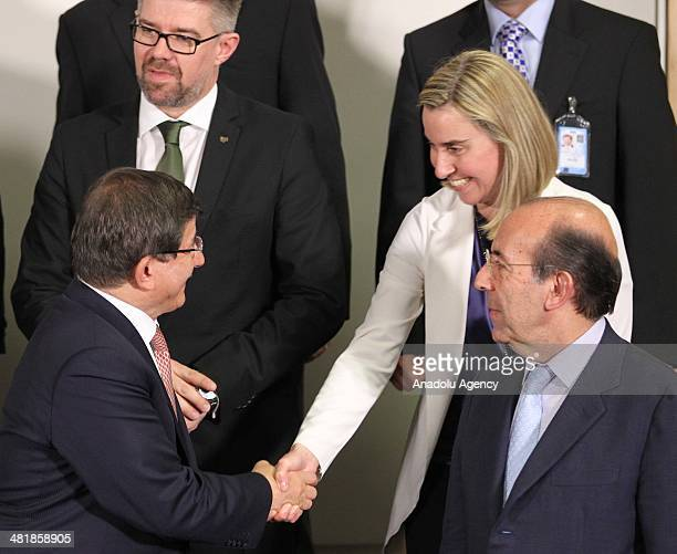 Turkish Foreign Minister Ahmet Davutolgu shakes hand with Italian Foreign Minister Federica Mogherini on the first day of the Foreign Affairs...