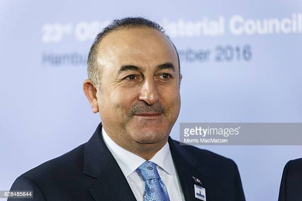 Turkish Foreign Minister Mevluet Cavusoglu smiles as he arrives for the summit of OCSE members states on December 8 2016 in Hamburg Germany Foreign...
