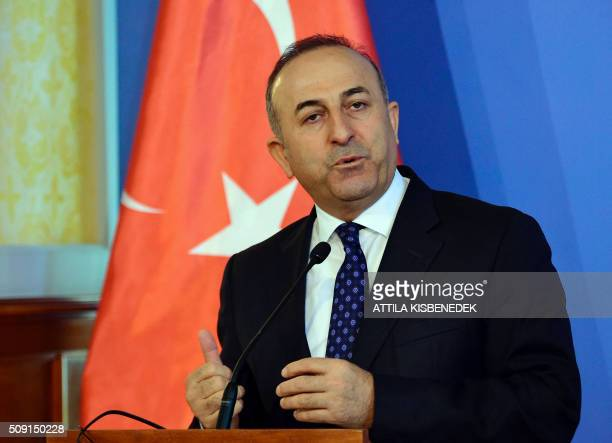 Turkish Foreign Minister Mevlut Cavusoglu addresses a joint press conference with Hungary's Minister of External Economy and Foreign Affairs Peter...