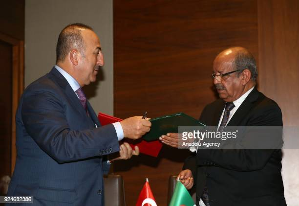 Turkish Foreign Minister Mevlut Cavusoglu and Algerian Foreign Minister Abdelkader Messahel exchange files during agreement signing ceremony with the...