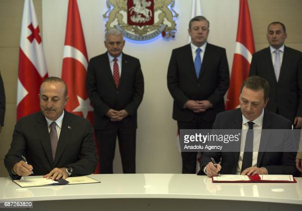 Turkish Foreign Minister Mevlut Cavusoglu and Georgian Culture and Monument Protection Minister Mikhail Giorgadze sign a Cultural Cooperation...