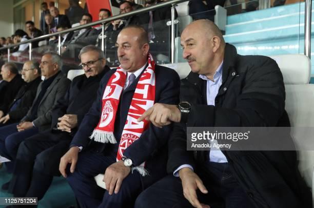 Turkish Foreign Minister Mevlut Cavusoglu and Head coach of Russian national football team Stanislav Cherchesov watch the Turkish Super Lig soccer...