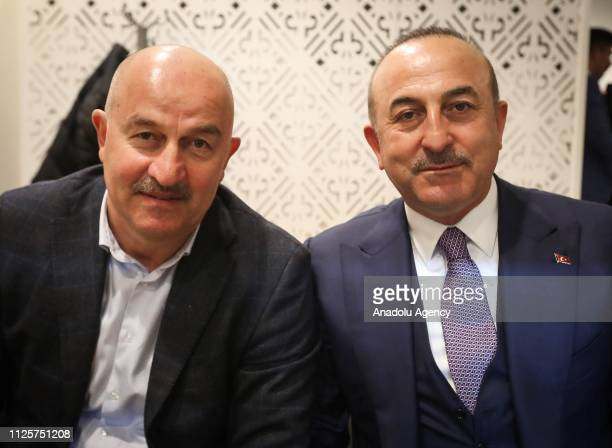 Turkish Foreign Minister Mevlut Cavusoglu and Head coach of Russian national football team Stanislav Cherchesov pose for a photo after watching the...