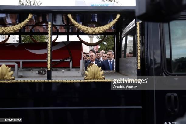 Turkish Foreign Minister Mevlut Cavusoglu and Head of the National Intelligence Organization of Turkey Hakan Fidan attend the funeral of Turkish...