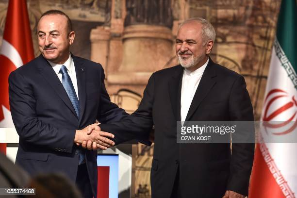 Turkish Foreign Minister Mevlut Cavusoglu and Iranian Foreign Minister Mohammad Javad Zarif shakes hands after a press conference on October 30, 2018...