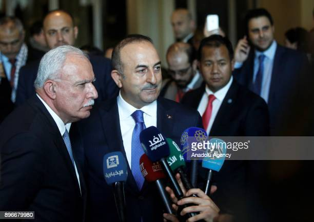 Turkish Foreign Minister Mevlut Cavusoglu and Palestinian Foreign Minister Riyad AlMaliki speak to media after the voting at emergency special...