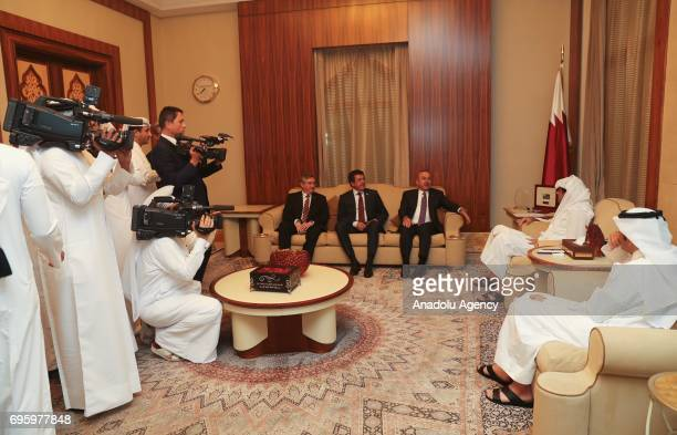 Turkish Foreign Minister Mevlut Cavusoglu and Turkish Economy Minister Nihat Zeybekci meet with Emir of Qatar Tamim bin Hamad Al Thani in Doha Qatar...