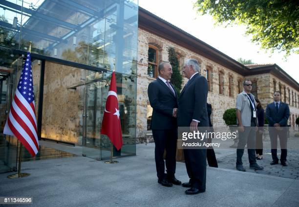 Turkish Foreign Minister Mevlut Cavusoglu and US Secretary of State Rex Tillerson shake hands as they pose for a photo before their meeting at...