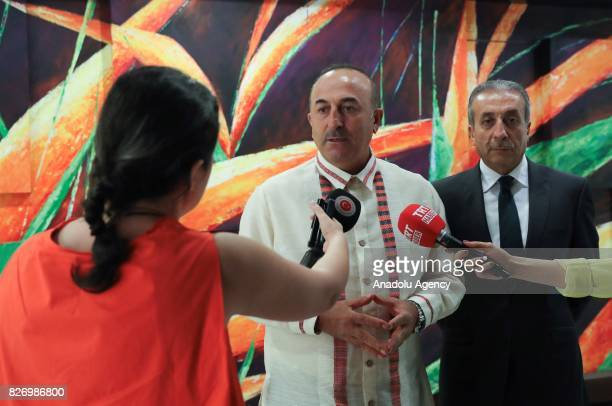 Turkish Foreign Minister Mevlut Cavusoglu and Vice Chairman of the Justice and Development Party Mehdi Eker answer press questions after a gala...