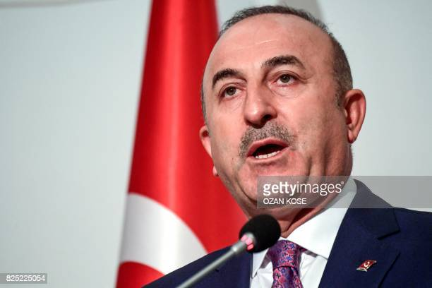 Turkish Foreign Minister Mevlut Cavusoglu attends a press conference after the Executive Committee Meeting of the Organisation of Islamic Cooperation...