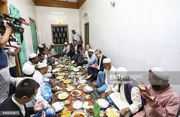 Turkish Foreign Minister Mevlut Cavusoglu attends an iftar dinner with meets Myanmarese muslims in Sittwe Myanmar on June 14 2016
