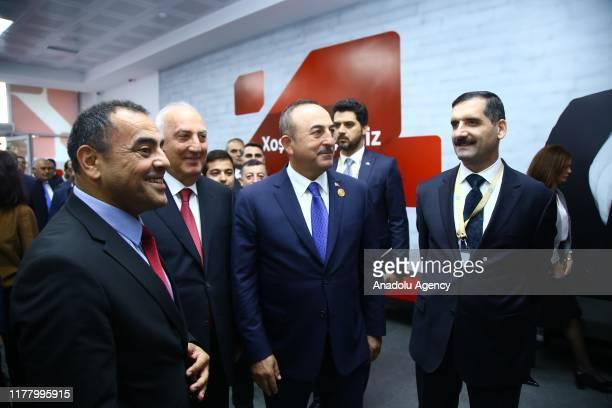 Turkish Foreign Minister Mevlut Cavusoglu attends the opening ceremony of Ziraat Bank Sumgayit branch in Baku Azerbaijan on October 25 2019