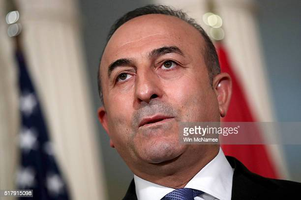 Turkish Foreign Minister Mevlut Cavusoglu delivers brief remarks before meeting with US Secretary of State John Kerry at the State Department March...