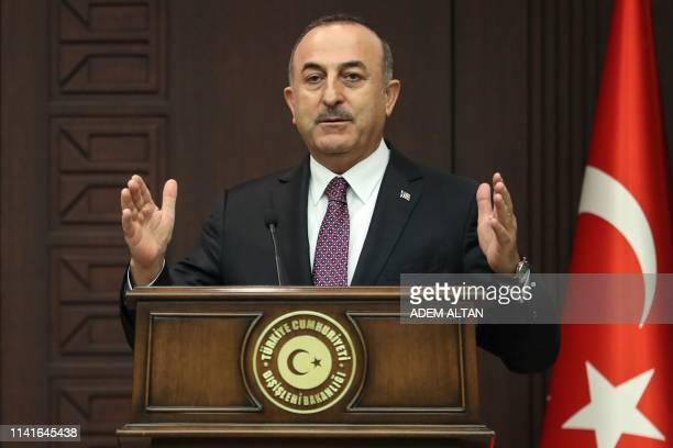 Turkish Foreign Minister Mevlut Cavusoglu gestures as he speaks during a joint press conference with NATO Secretary General at Cankaya Palace in...