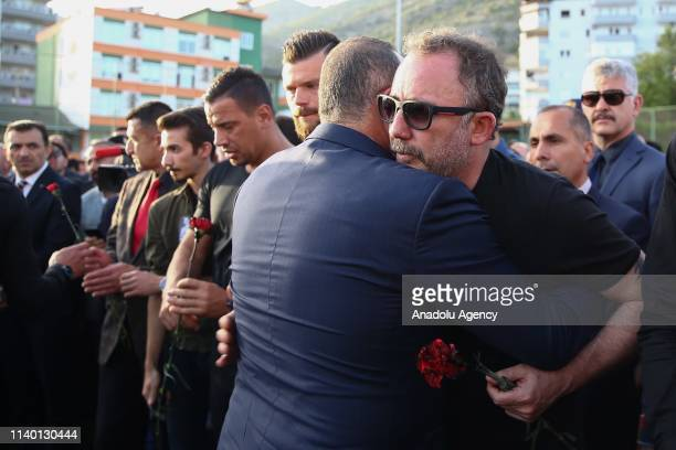 Turkish Foreign Minister Mevlut Cavusoglu gives condolence to head coach of Aytemiz Alanyaspor Sergen Yalcin during a ceremony held for Czech striker...