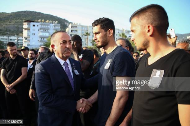 Turkish Foreign Minister Mevlut Cavusoglu gives condolence to players of Aytemiz Alanyaspor during a ceremony held for Czech striker of Turkish...
