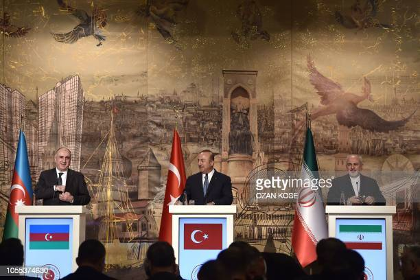 Turkish Foreign Minister Mevlut Cavusoglu , Iranian Foreign Minister Mohammad Javad Zarif attend a press conference on October 30, 2018 in Istanbul.