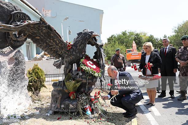 Turkish Foreign Minister Mevlut Cavusoglu leaves red flowers at Police Special Operation Department's Headquarters in Golbasi district of Ankara...